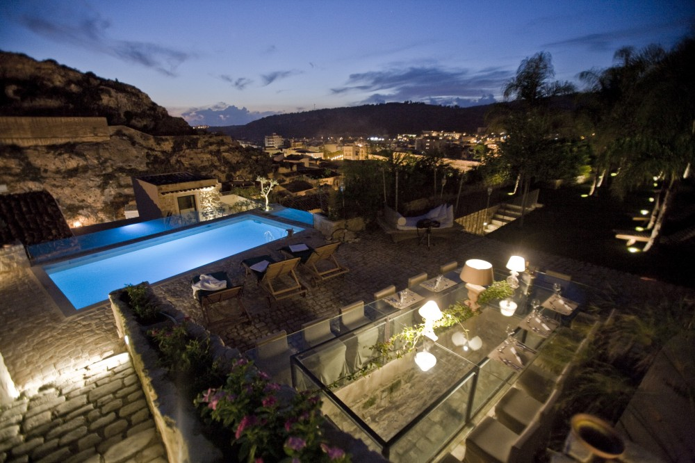 The pool terrace in the evening with dusk falling over Scicli.
